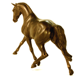 cold cast bronze of a  half passing thoroughbred